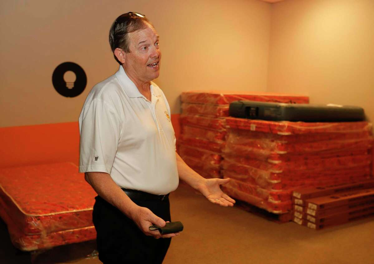 Larry Cress, vice chairman of Houston Furniture Bank, talks about the orgnization's No Kids on the Floor program at their new location on Sawdust Road, Friday, Oct. 23, 2020, in The Woodlands. The organization partners with several non-profits to operates as a furniture outlet, warehouse and helps recycle mattresses.