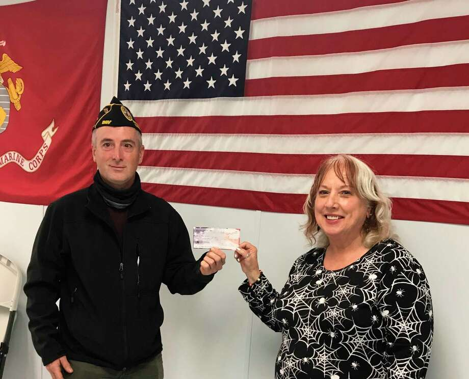Eric Sullivan (left), director of Manistee Veterans Affairs, is presented a check by Pati Potes, president of the Manistee American Legion Auxiliary. (Courtesy photo)