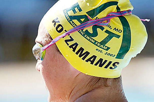 Eleni Kotzamanis of Alton has top times that place her as the swimmer to beat in the 200- and 500-yard freestyle races at Saturday's Edwardsville IHSA Girls Swim Sectional. Kotzamanis, a Kansas recruit, is pictured at a Flyers Aquatic Swim Team meet.