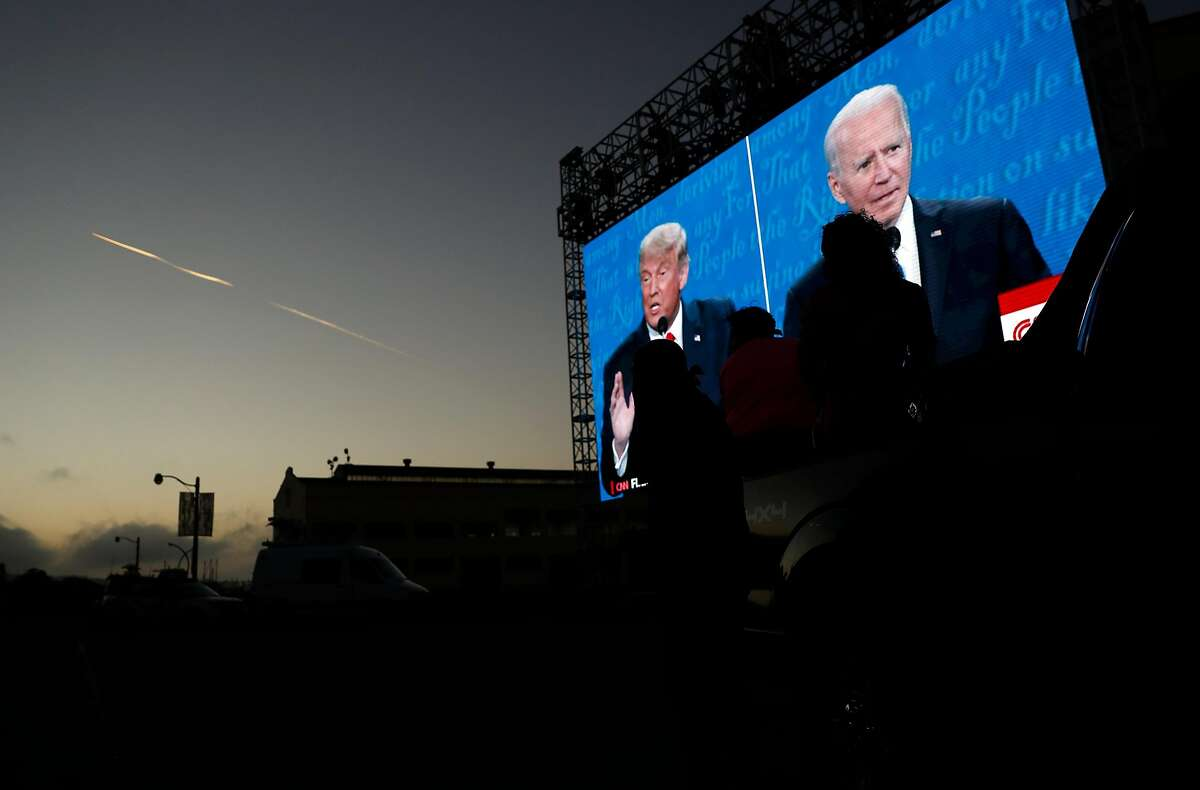 The final US Presidential debate between President Donald J. Trump and former Vice President Joe Biden is shown on a video screen at Fort Mason in San Francisco, Calif., on Thursday, October 22, 2020. The drive in debate watch party was organized by businessman Manny Yekutiel.