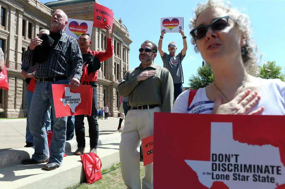 The Texas State Board of Social Work Examiners recent decision to change its code of conduct allowing social workers to refuse services based on a client's disability, sexual orientation or gender identity or expression is a license to discriminate. Here, marchers rally in support of the LGBTQ community in Austin in 2017. Photo: JERRY LARA /San Antonio Express-News / © 2017 San Antonio Express-News