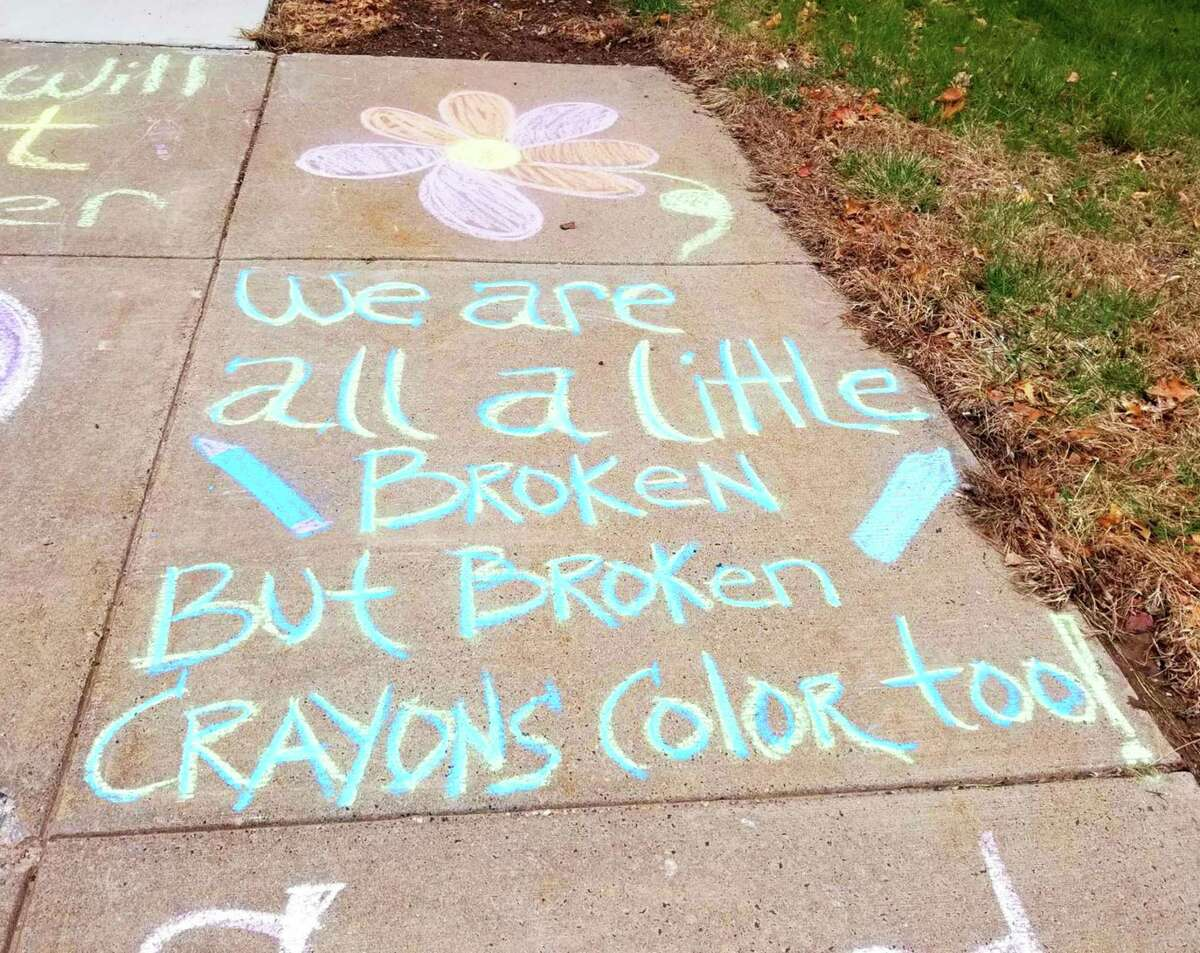 Children at the Department of Children and Families Albert J. Solnit Center in Middletown, a psychiatric facility for minors with severe mental illness/behavioral problems, wrote with chalk on sidewalks around campus as part of therapy and to boost staff morale in May.
