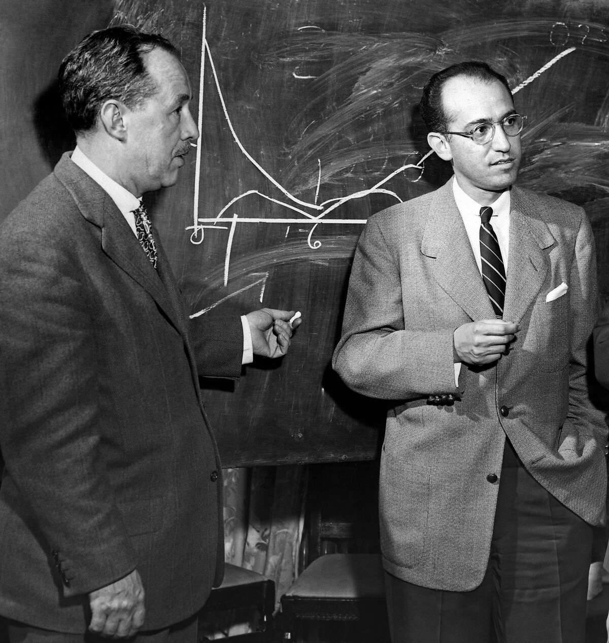 This March 25, 1955 photo shows Dr. Thomas Francis, Jr. of the University of Michigan, left, and his former student, Dr. Jonas Salk of Pittsburgh. Salk has developed and tested an anti-polio vaccine which may be ready for 18,000,000 children this spring and summer. (AP Photo)