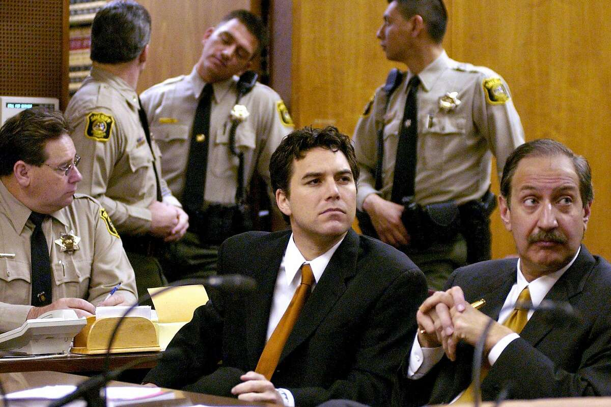 Scott Peterson sits with his attorney Mark Geragos, right, during arraignment proceedings in Stanislaus Superior Court on Dec. 3, 2003.