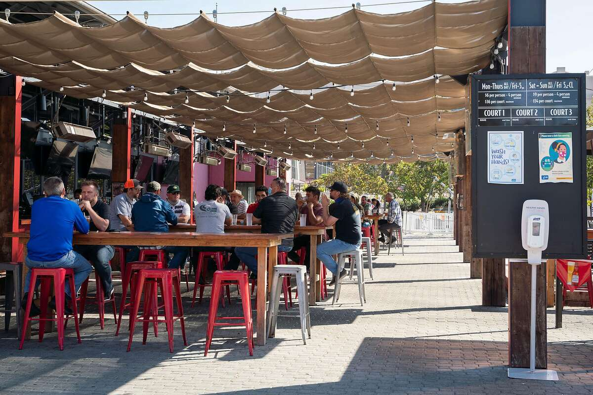 Dozens of people eat outdoors at Plank. The beer garden has been open since June, and the restaurant expanded services Friday.