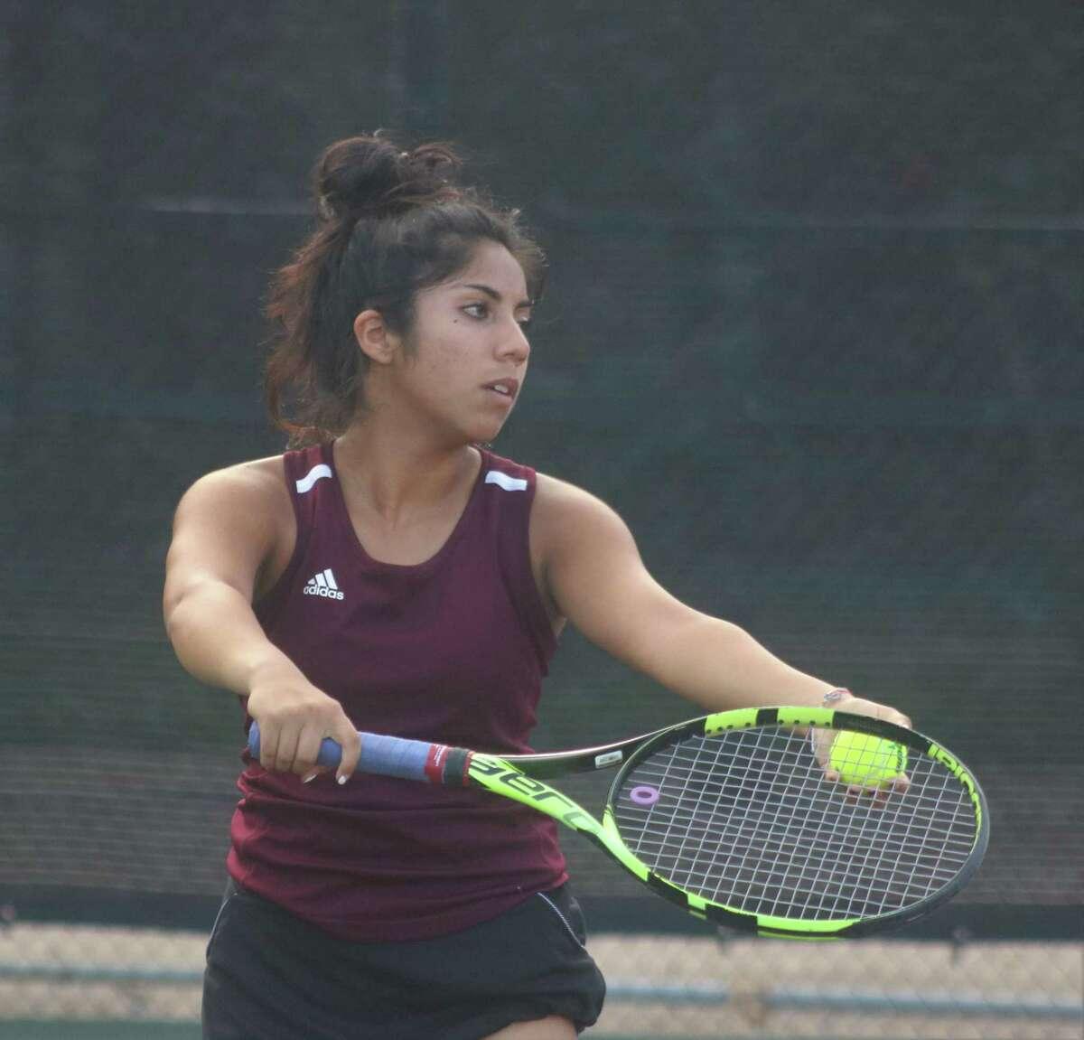 Lourdes Zuniga-Montemayor prepares to serve during her singles match victory against Memorial this week.