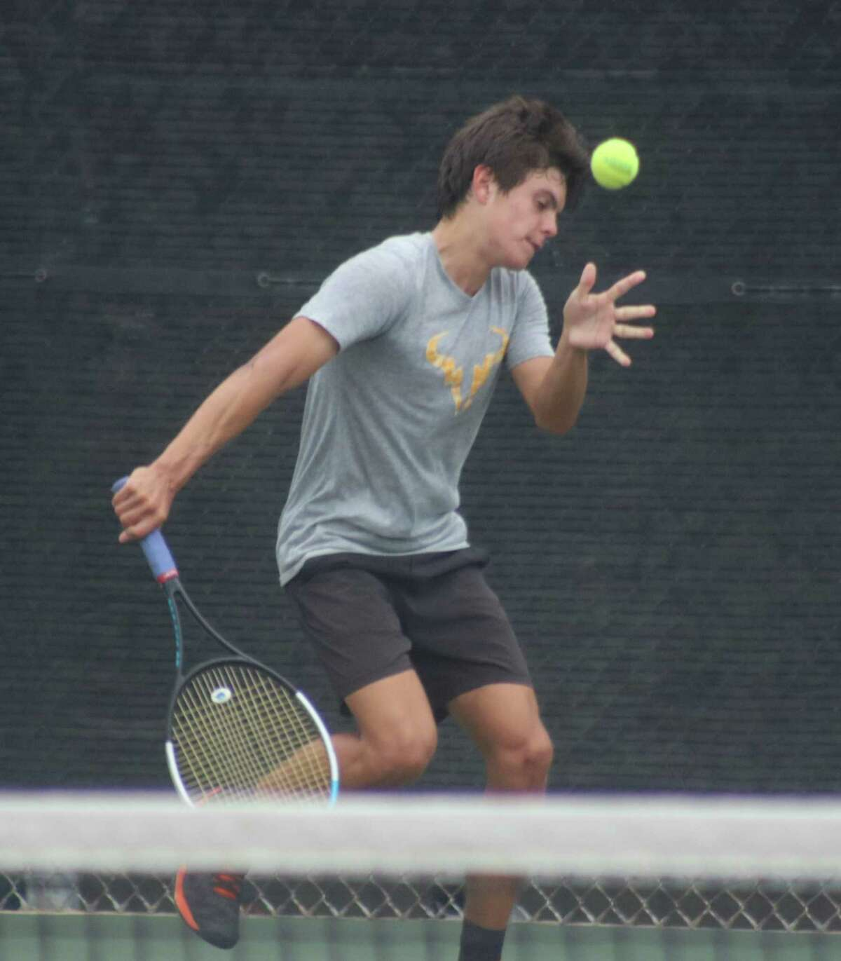 Diego Cromeens returns a tough delivery by a teammate during practice this week. The junior now concentrates on the state playoffs that starts Tuesday.