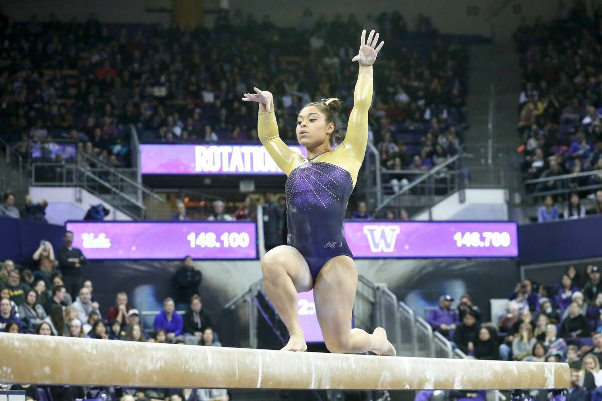 SEATTLE, WA - FEBRUARY 10: Washington gymnast Evanni Roberson performs her routine on the balance beam during a women's college gymnastics meet between the UCLA Bruins and the Washington Huskies on February 10, 2019, at Alaska Airlines Arena in Seattle, WA. (Photo by Jesse Beals/Icon Sportswire via Getty Images)