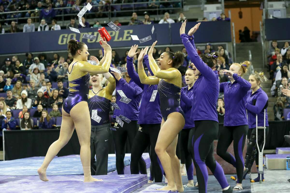 SEATTLE, WA - FEBRUARY 10: Washington gymnast Brenna Brooks celebrates with teammates after scoring a 9.800 performs her routine on the balance beam during a women's college gymnastics meet between the UCLA Bruins and the Washington Huskies on February 10, 2019, at Alaska Airlines Arena in Seattle, WA. (Photo by Jesse Beals/Icon Sportswire via Getty Images)