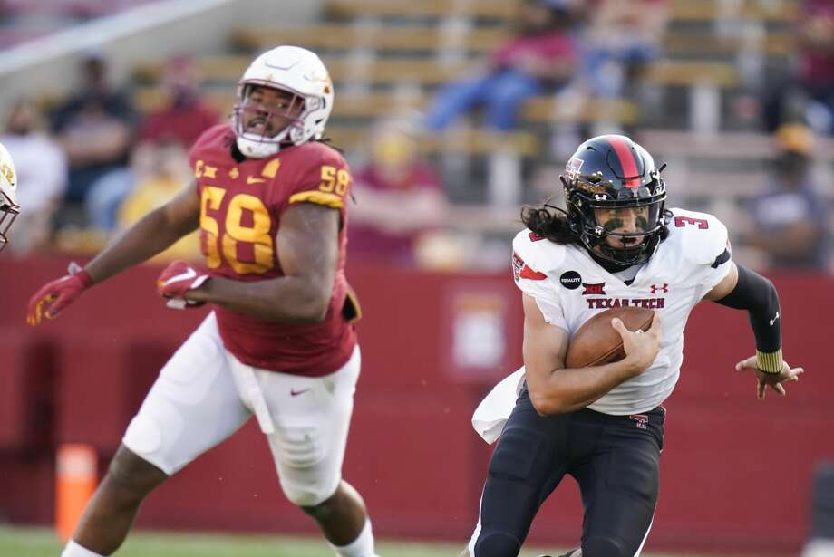 Texas Tech quarterback Henry Colombi (3) runs from Iowa State defensive end Eyioma Uwazurike (58) during the second half of an NCAA college football game, Saturday, Oct. 10, 2020, in Ames, Iowa. Iowa State won 31-15. (AP Photo/Charlie Neibergall) Photo: Charlie Neibergall/Associated Press / Copyright 2020 The Associated Press. All rights reserved