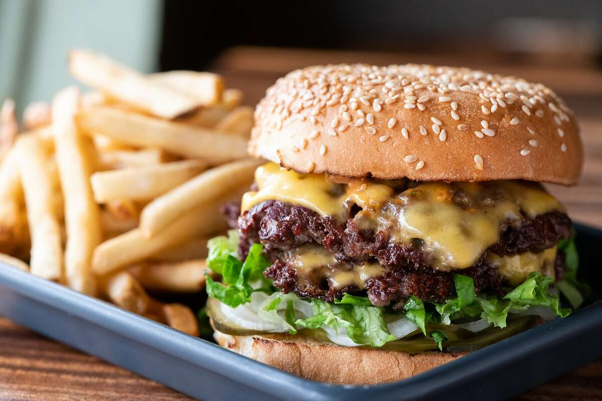 San Francisco restaurant Causwell's helped popularize smash-style burgers in the Bay Area. The chefs smash two beef patties until they're thin and crispy.