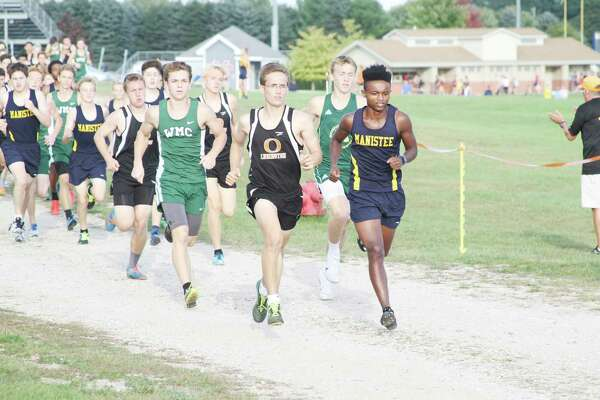 Manistee's Ransom Hoeflinger leads the field last year at a cross country meet in Manistee. Hoeflinger learned he was ineligible to run this year on a technicality. (News Advocate file photo)