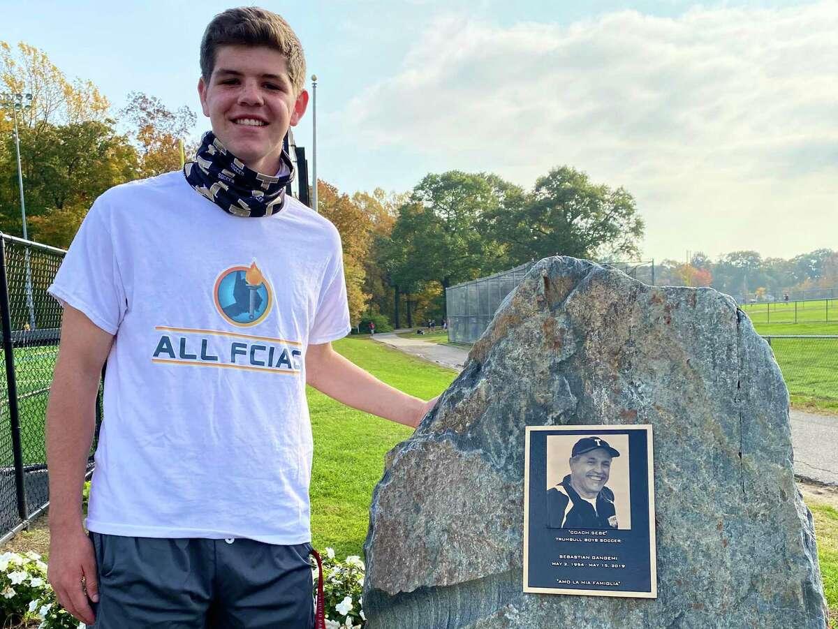 Trumbull's Carrigan Cullinan next to a memorial for former coach Sebastian Gangemi.