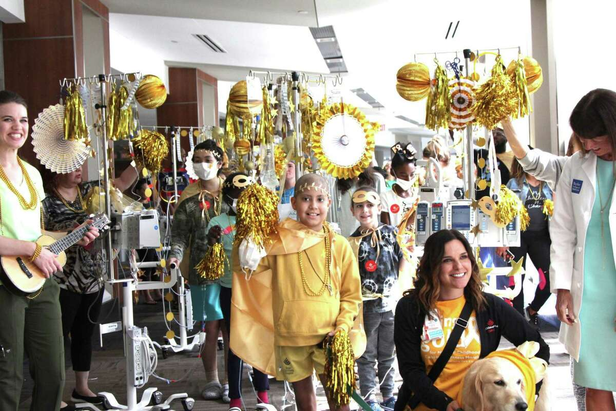 """The Faris Foundation's """"Let there be GOLD"""" campaign was inspired by the battle of Faris Virani, center, who ultimately died while battling Ewing's sarcoma for three years."""