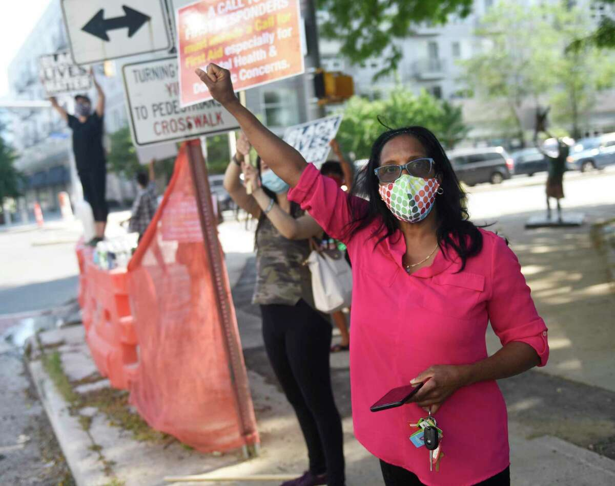 Steven Barrier's mother, Valerie Jaddo, stands with protestors from the Latham Abolition Camp outside the Stamford Government Center on July 16. Jaddo and her attorneys met with Stamford public safety officials Thursday to discuss the incident report involving the death of her son.