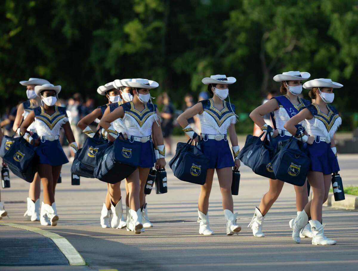 Cypress Ranch drill team arriving Thursday, Oct. 22, at Cy-Fair FCU Stadium in Cypress. Director of Fine Arts Mary Running said fine arts teachers have been working throughout the 2020-21 school year to ensure safe individual and group opportunities for both on-campus and CFISD Connect students.