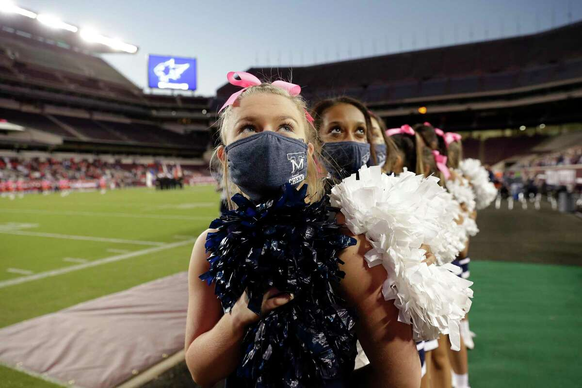 Tomball Memorial Wildcats cheerleaders during the National Anthem before the first half of a high school football game against Tomball played at Kyle Field Friday, Oct. 16, in College Station. Director of Fine Arts JD Janda said every program is operating at almost full capacity.