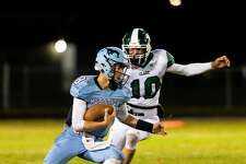 Meridian's Cameron Metzger runs the ball during a game against Clare Friday, Oct. 23 at Meridian Early College High School. (Cody Scanlan/for the Daily News)