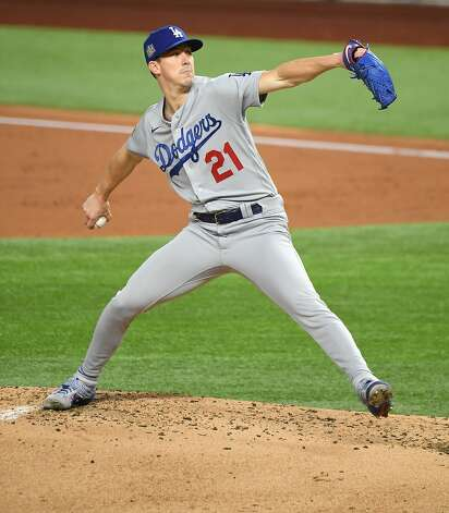 Los Angeles Dodgers pitcher Walker Buehler throws a pitch against the Tampa Bay Rays in the first inning in Game 3 of the World Series on Friday, Oct. 23, 2020 at Globe Life Field in Arlington, Texas. (Wally Skalij/Los Angeles Times/TNS) Photo: Wally Skalij, TNS