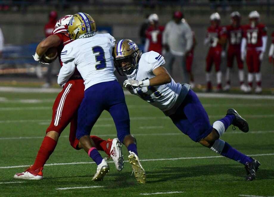 Midland High's Kobe Esquibel (41) and Preston Brockington (3) tackle Odessa High's Jesse Cervantes on Friday, Oct. 23, 2020 at Ratliff Stadium. Jacy Lewis/Reporter-Telegram Photo: Jacy Lewis/Reporter-Telegram