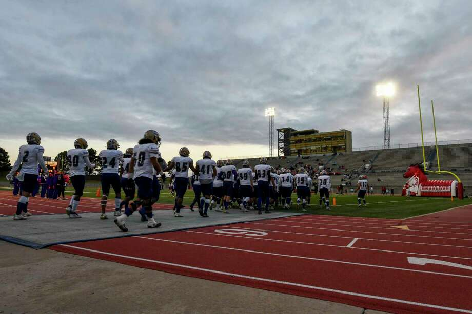Midland High players take the field to face Odessa High on Friday, Oct. 23, 2020 at Ratliff Stadium.   Jacy Lewis/Reporter-Telegram Photo: Jacy Lewis/Reporter-Telegram
