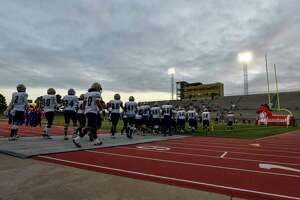 Midland High players take the field to face Odessa High on Friday, Oct. 23, 2020 at Ratliff Stadium.   Jacy Lewis/Reporter-Telegram