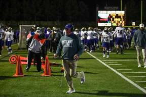 Midland High?•s head coach Tim Anuszkiewicz goes to the locker room at halftime Friday, Oct. 23, 2020 at Ratliff Stadium. Jacy Lewis/Reporter-Telegram