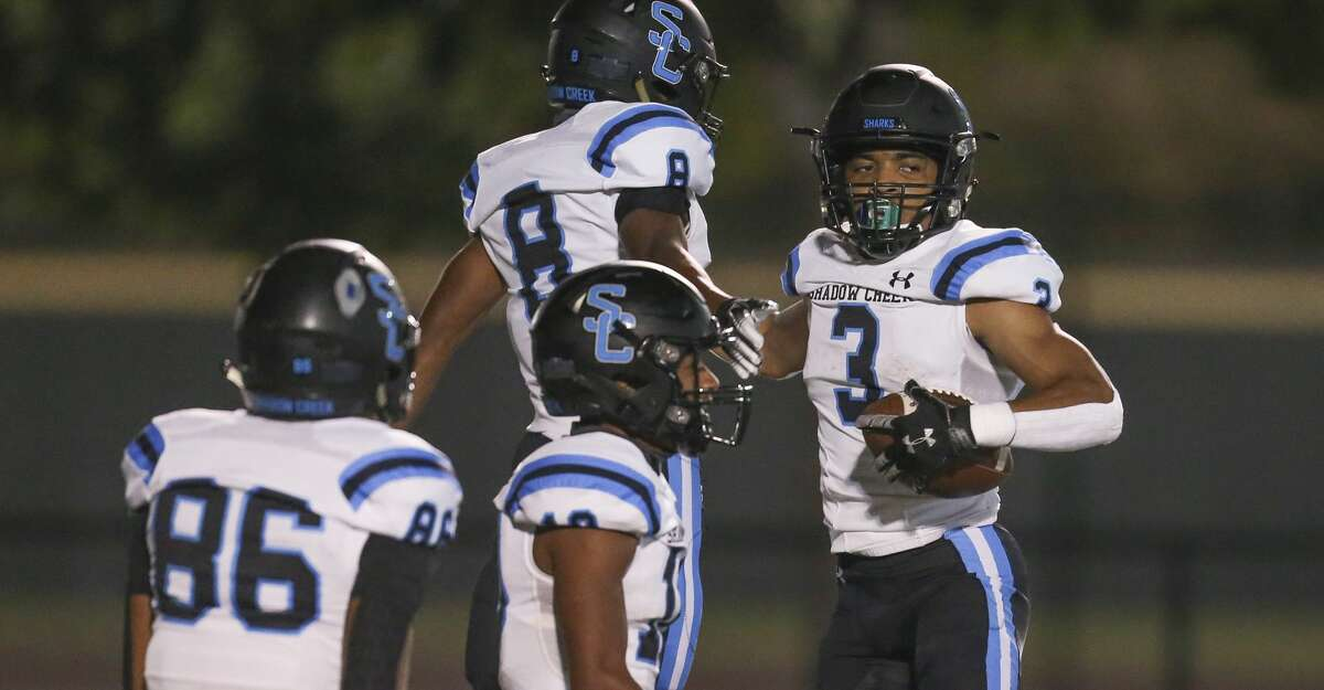 Shadow Creek running back Kelvon Brown (3) celebrates his rushing touchdown against Stake Jesuit In the first quarter on October 23, 200 at Crusader Stadium in Houston, Texas .