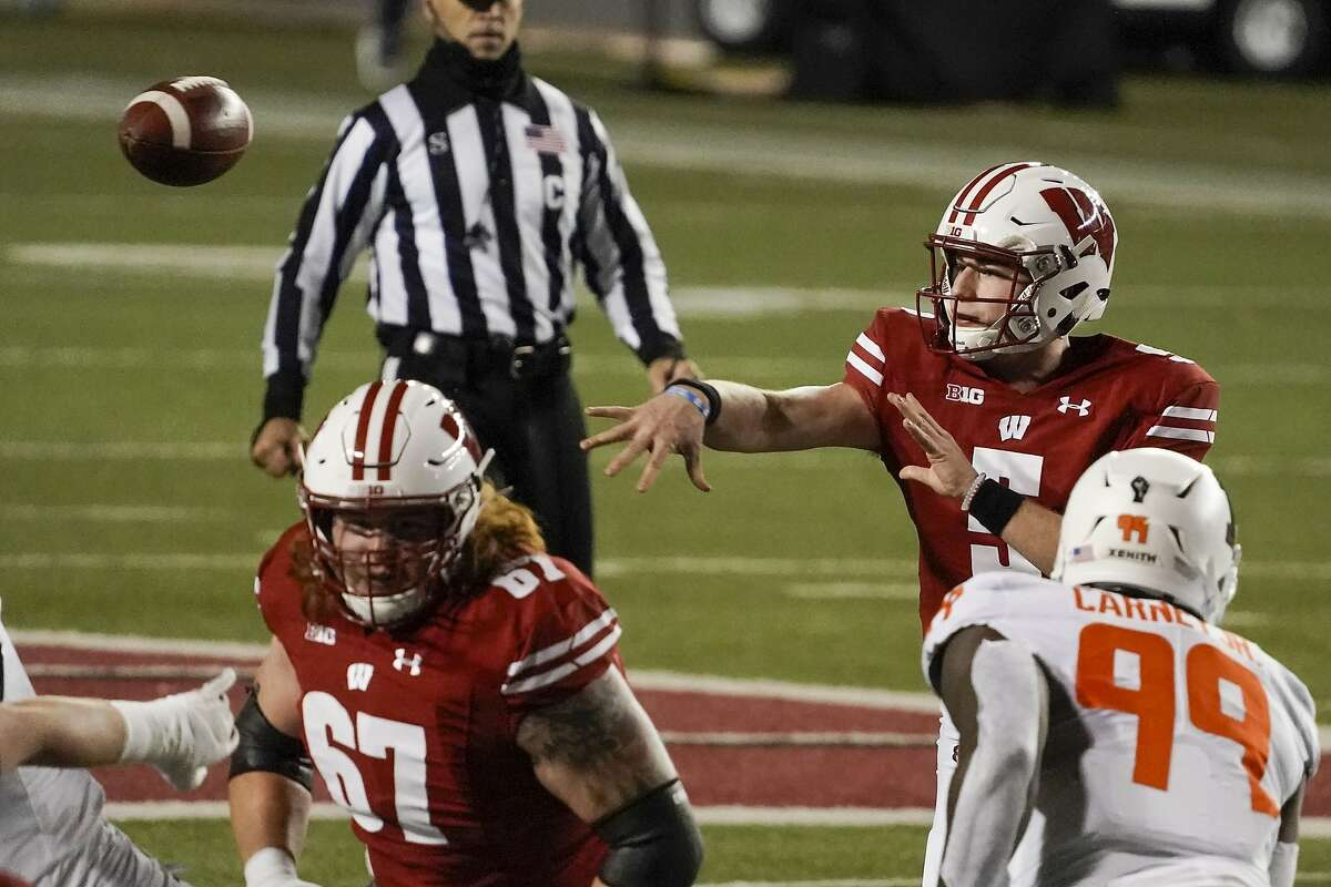 Wisconsin quarterback Graham Mertz led the Badgers past Illinois on Oct. 23, but he and 26 others in the program have since tested positive for the coronavirus.