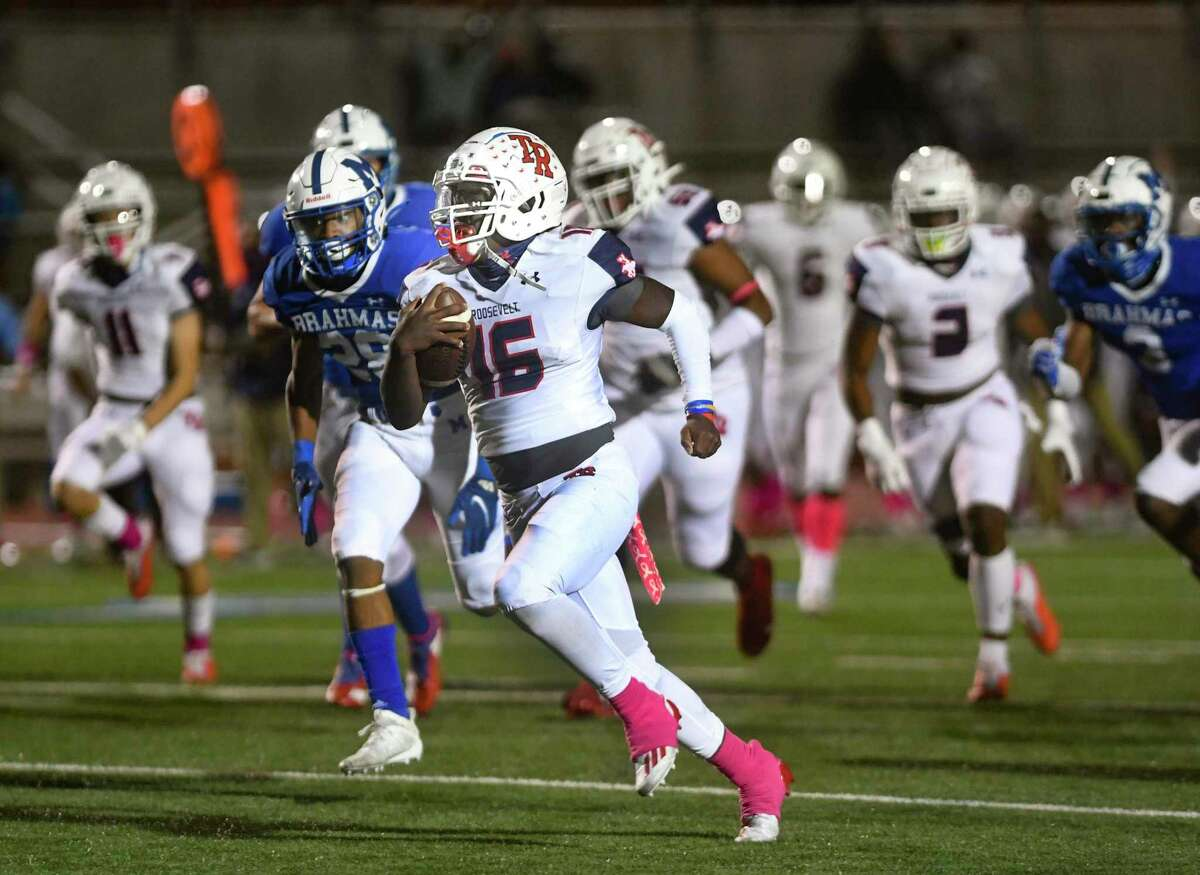 Roosevelt quarterback Dewayne Coleman runs for one of his five touchdowns against MacArthur on Friday at Heroes Stadium. He rushed for 181 yards and passed for 91 more.