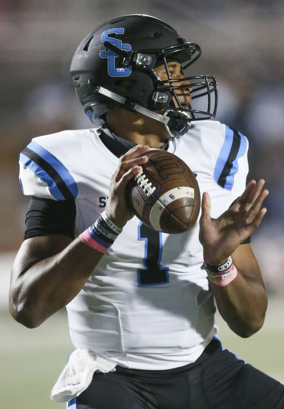 Shadow Creek quarterback Kyron Drones (1) drops back in the pocket against Strake Jesuit In the first quarter on October 23, 200 at Crusader Stadium in Houston, Texas .