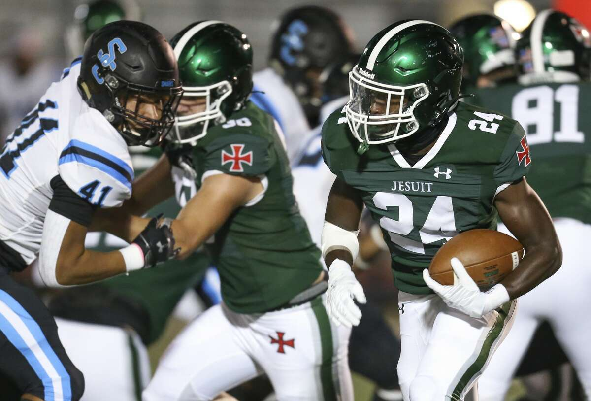 Strake Jesuit running back Alex May (24) rushes against Shadow Creek outs linebacker Jordan Best (41) In the first quarter on October 23, 200 at Crusader Stadium in Houston, Texas .