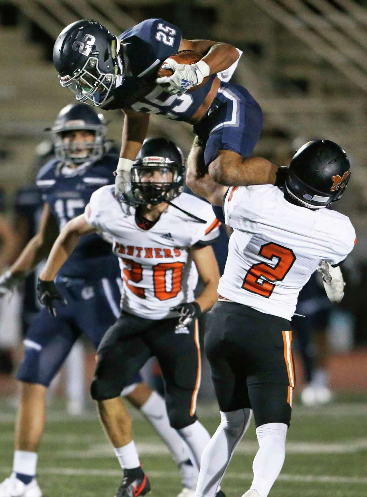 Alex Rodriguez jumps over Tyler Mangum to get some extra yards as Boerne Champion hosts Medina Valley at Greyhound Stadium on Oct.23, 2020.