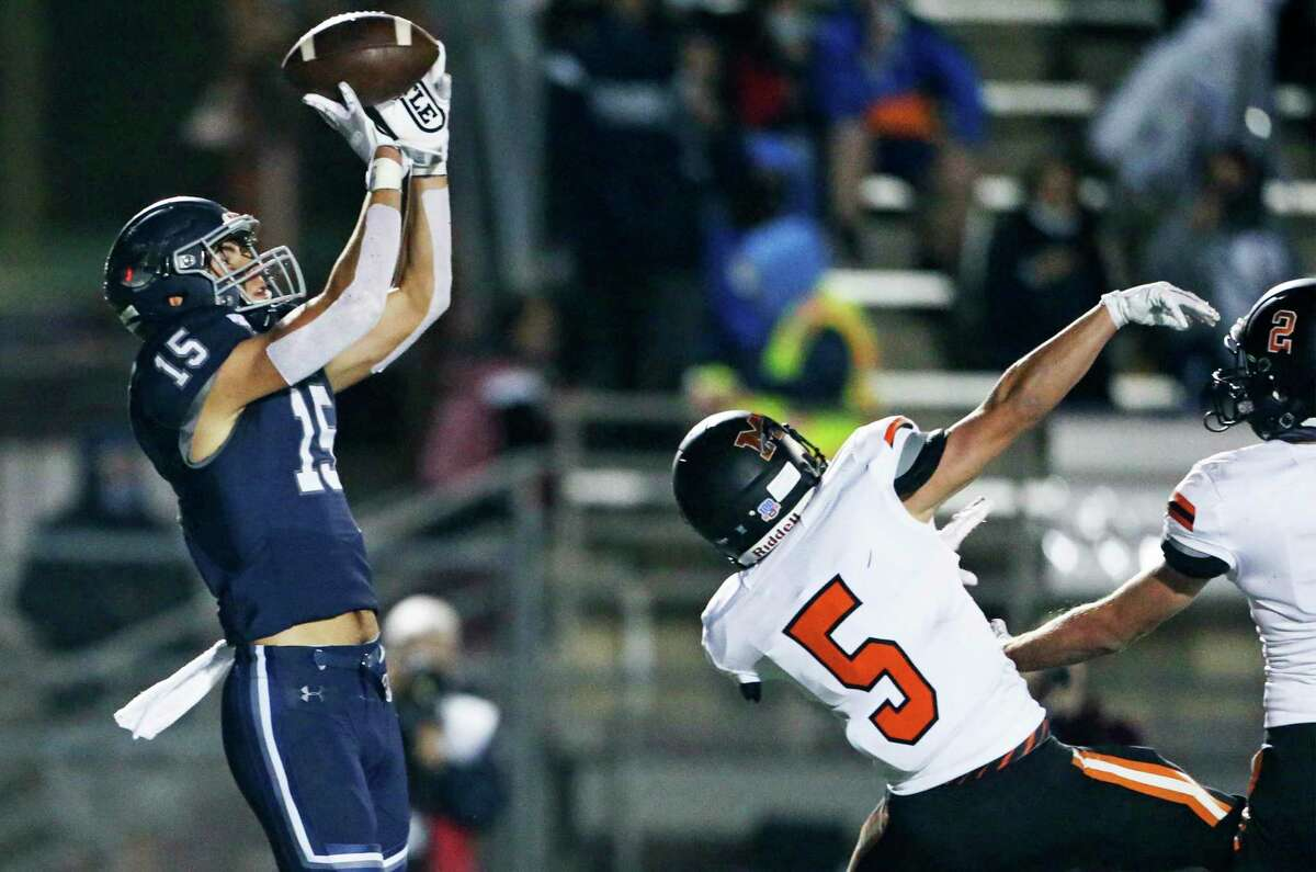 Charger receiver Reed Cantrell goes high to pull in a long pass which he takes into the end zone as Boerne Champion hosts Medina Valley at Greyhound Stadium on Oct.23, 2020.