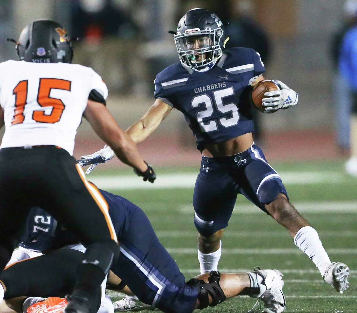 Chargers srunning back Alex Rodriguez steps out to make a move away from Seth Bullard as Boerne Champion hosts Medina Valley at Greyhound Stadium on Oct. 23, 2020.