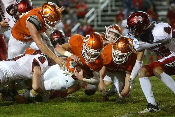 Orangefield's Dwight Davis is brought down by Bridge City's defense during the Bayou Bowl in Orangefield. Photo taken Friday, October 23, 2020 Kim Brent/The Enterprise