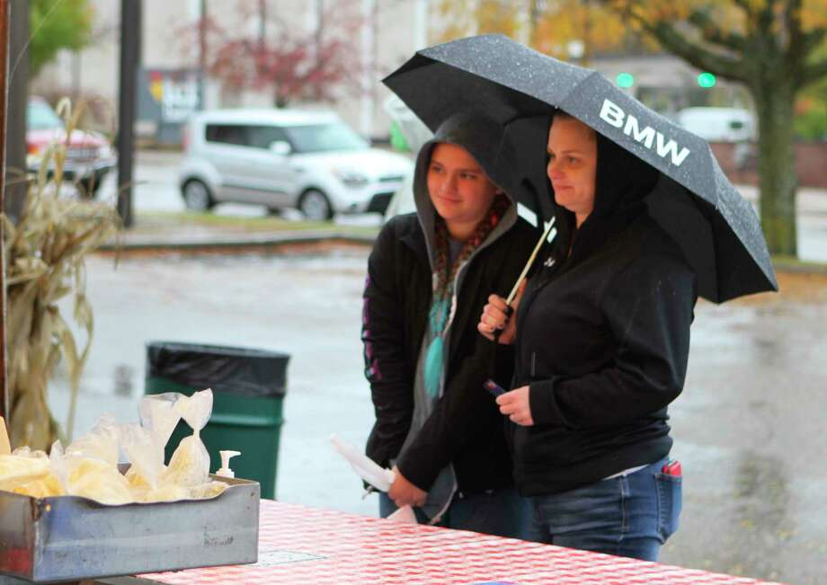 Despite the rainy and blustery weather, area residents attended the Big Rapids Downtown Farmers Market on Friday to shop forartisanal cheese, fresh popcorn, crisp apples and more. The popular farmers market takes place annually each Tuesday and Friday from May through October and features a variety of vendors from around the region.(Pioneer photo/Taylor Fussman)