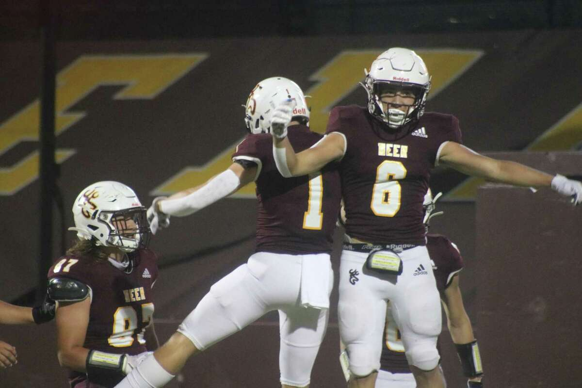 Alex Argueta (6) celebrates with Tyler Bowles after Argueta scored on a 12-yard run to raise the lead to 14-6 Friday night.