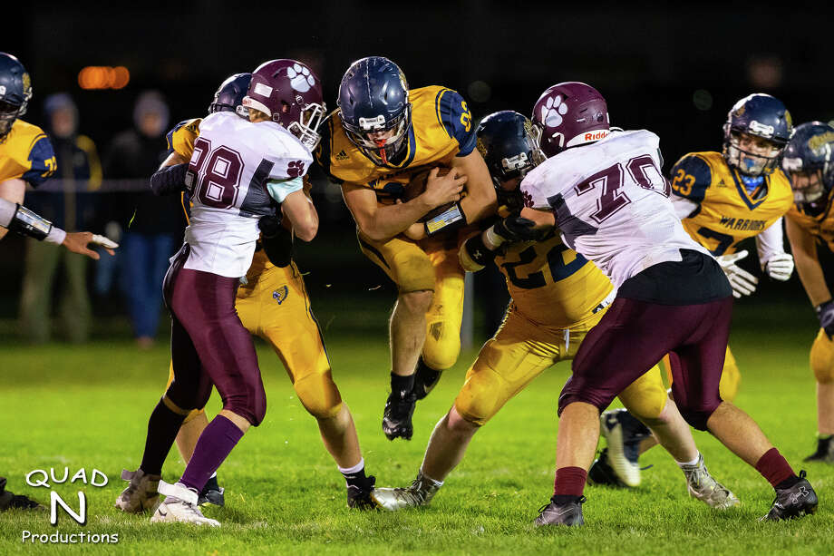 The North Huron Warriors varsity football team fell just shy of an unbeaten regular season on Friday night, falling at home to a tough Mayville team, 48-28. Photo: Kaitlin's Klicks, Quad N Productions/For The Tribune  / copyright Kaitlin Gunsell