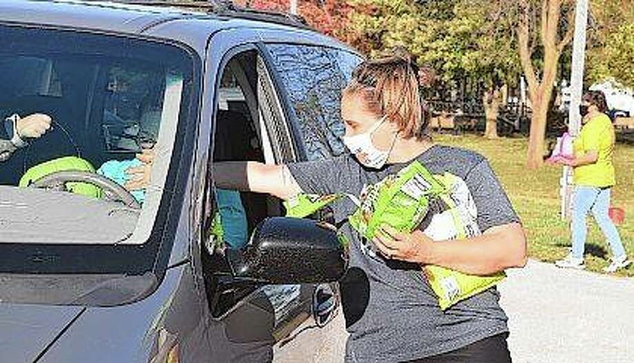 Tia Kephart of WJVO/WJIL radio stations passes out candy Thursday during the station's Safe Halloween event at Prairie Land Heritage Museum. Photo: Samantha McDaniel-Ogletree | Journal-Courier