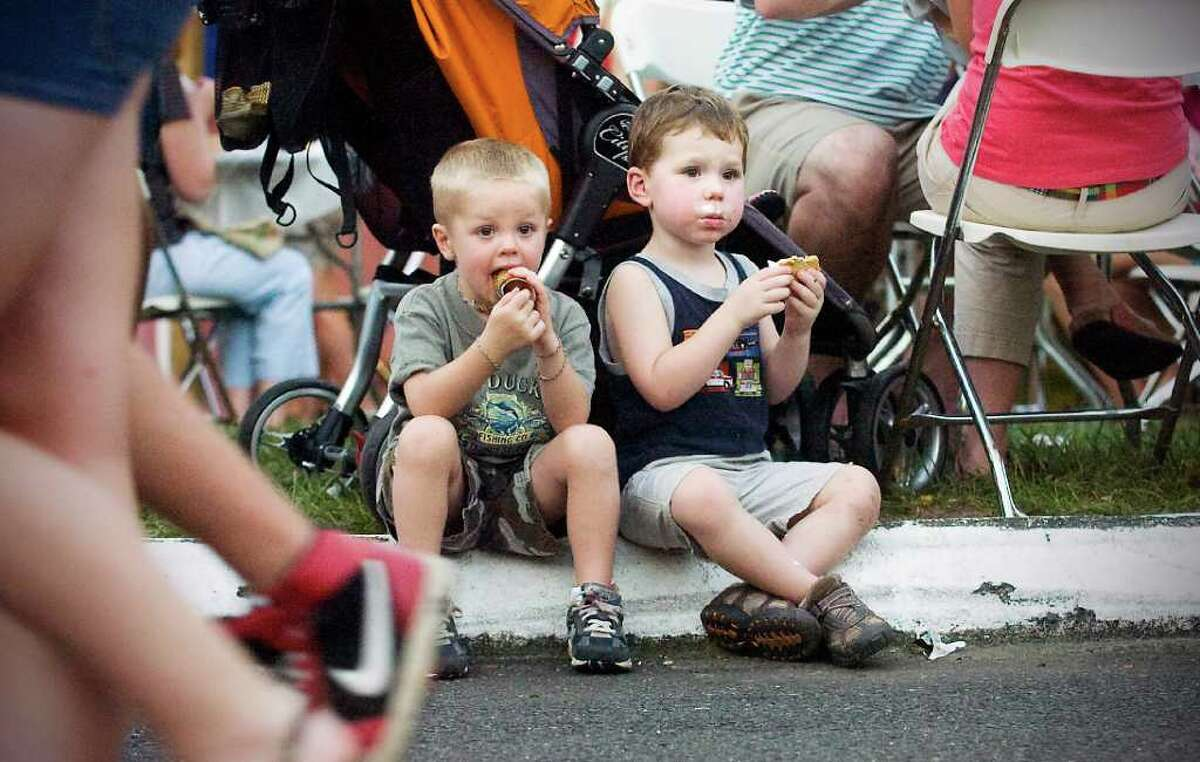 Montana Gilzerist, 4, and Mason Lombardo, 3, enjoy some ice cream at the Annual St. Leo's Parish Fair in Stamford, Conn. on Tuesday August 31, 2010. The fair runs through Saturday.