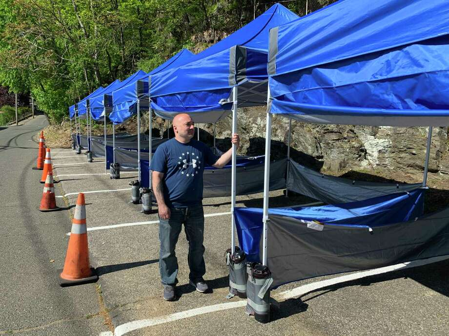 Back in April, Jason Carlucci reconfigured his parking lot with tent covered benches allowing the Derby's Dew Drop Inn to offer outside dining. Photo: / Michael P. Mayko