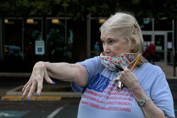 Margery Erp shows off her election-themed nails after voting on her 85th birthday at the AT&T Center. A reader heaps praise on election workers.