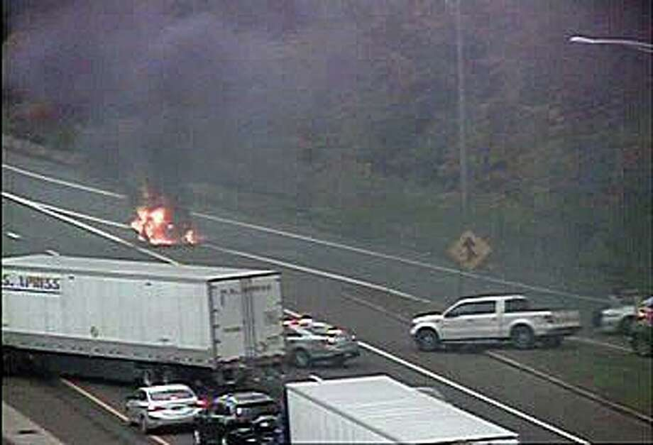 A vehicle fire has closed two lanes of I-95 on Saturday morning on Oct. 24, 2020. The fire, reported at 9:40 a.m. has closed the southbound right and center lanes between exits 41 and 40. Photo: CT DOT Traffic Cam