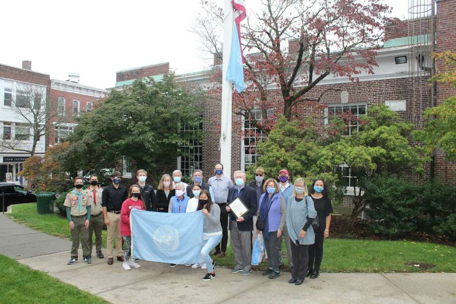 First Selectman Kevin Moynihan, Boy Scouts, members of the New Canaan UN Committee and members of the Model UN at New Canaan High School gather in front of Town Hall Saturday morning, Oct. 24, to raise the UN flag. Moynihan proclaimed Saturday — the 75th anniversary of the United Nations — as UN Day in New Canaan, an annual tradition. Photo: John Kovach / Hearst Connecticut Media / New Canaan Advertiser