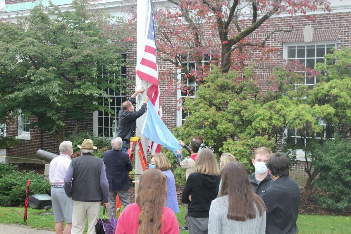 The UN Flag is prepared to be raised on the flagpole in front of New Canaan Town Hall Saturday, 0ct. 24, which was the 75th anniversary of the United Nations and UN Day in New Canaan.