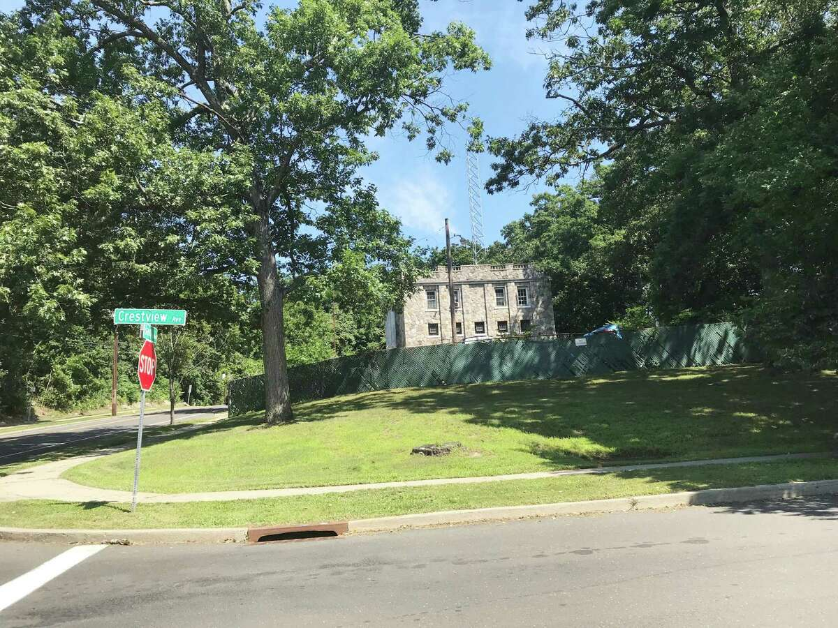 Property the city owns at Haig and Crestview avenues in Springdale - one parcel is occupied by an abandoned basketball court and the other by a 1941 stone building that once housed a police precinct - could be put up for sale.