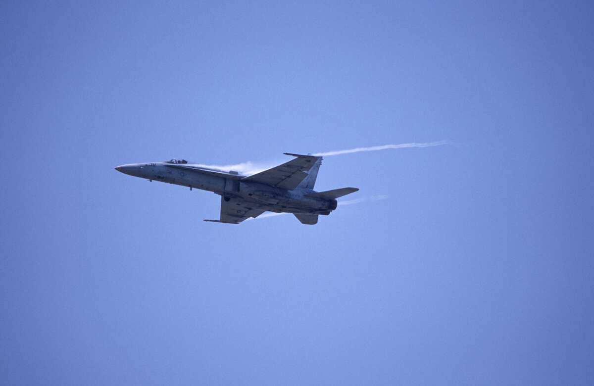 FILE - FA-18 aircraft initiates a steep climb. Two F/A-18s and a propeller plane were seen above San Francisco and MarinThursday.