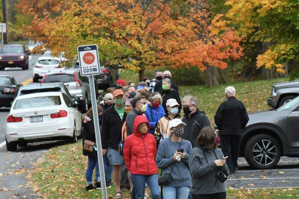 Voters stand in line at the Bethlehem Lutheran Church polling station on the first day of early voting in New York State on Saturday, Oct. 24, 2020, on Elm Avenue in Delmar, N.Y. Early voting polls are open at varying hours throughout the week until Sunday, November 1. (Will Waldron/Times Union)