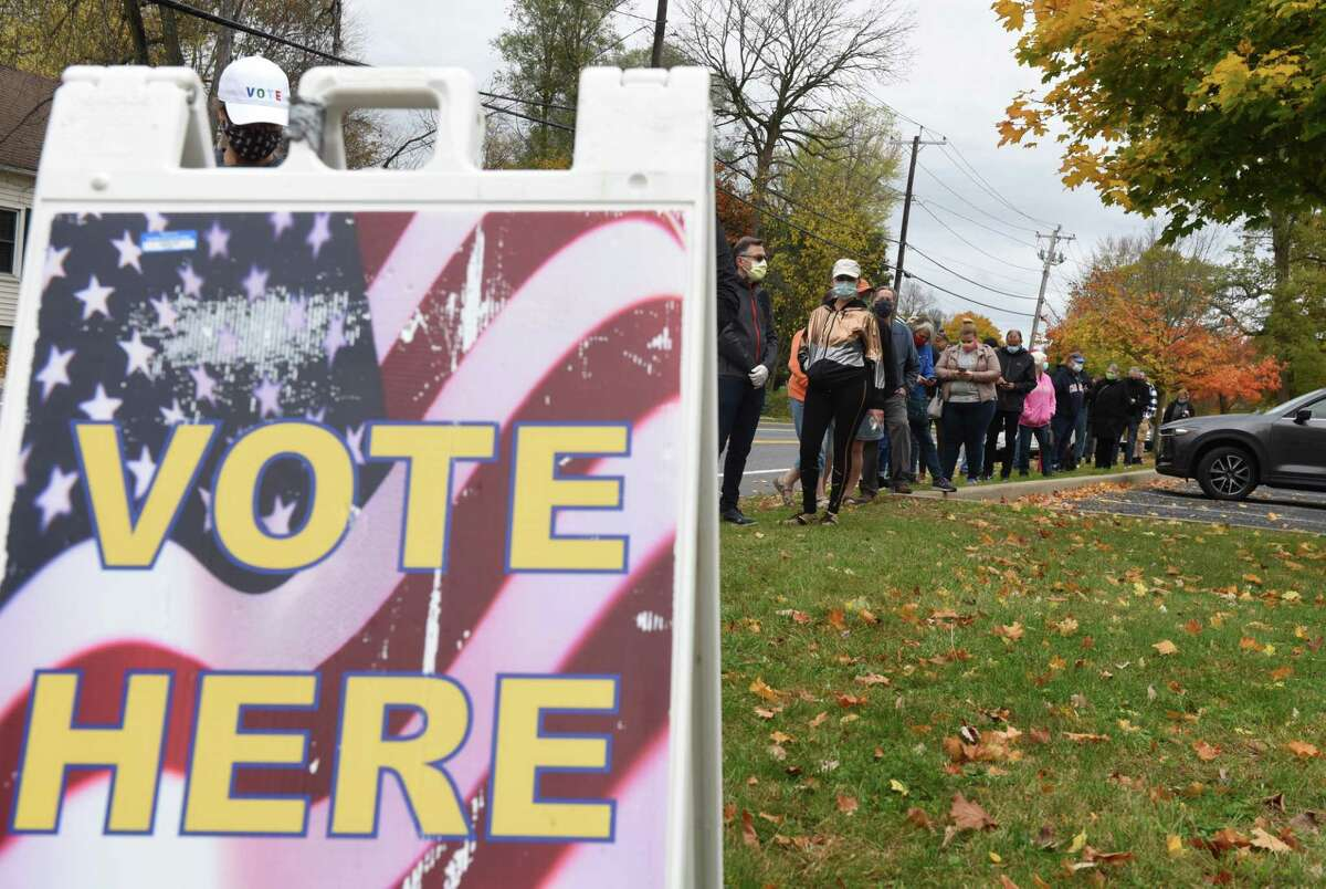 Voters stand in line at the Bethlehem Lutheran Church polling station on the first day of early voting in New York State on Saturday, Oct. 24, 2020, on Elm Avenue in Delmar, N.Y. (Will Waldron/Times Union)